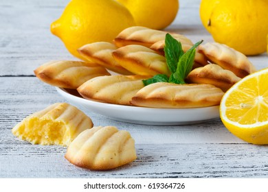 Freshly baked french madeleines with lemon