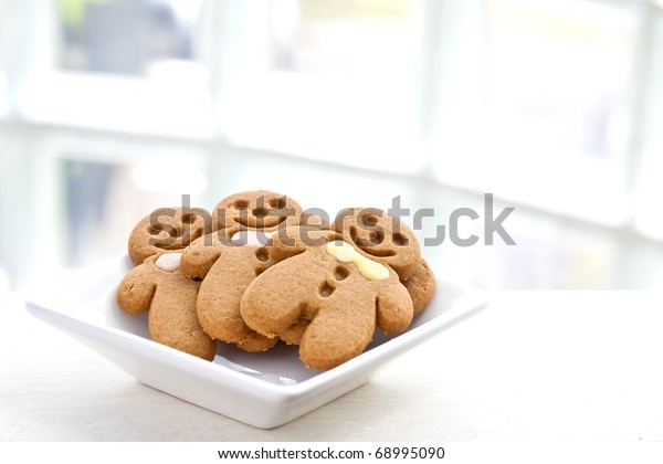 Freshly baked gingerbread biscuit in white plate