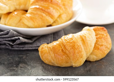 Freshly baked golden and tasty croissants in a bowl