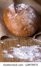 Freshly baked homemade bread dusted with flour