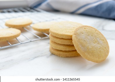 Freshly baked homemade butter shortbread biscuits dusted with sugar, selective focus
