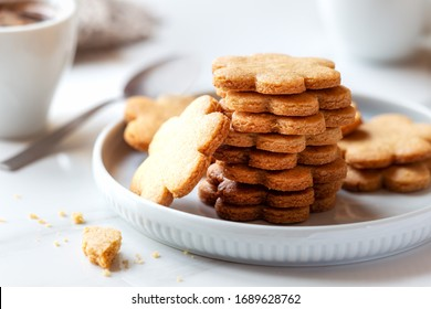 Freshly baked homemade cookies for breakfast with a cup of coffee at the background. Good morning concept