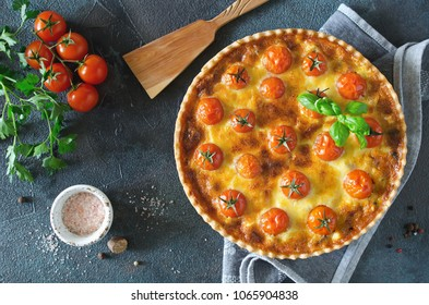 Freshly baked homemade pie quiche Lorraine on a concrete background. Traditional French pastries