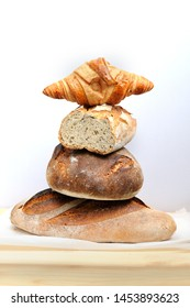 Freshly baked hommade organic bread in rustic setting. Bakery. Close-up on traditional bread.
