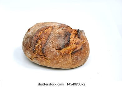 Freshly baked hommade organic bread on white background. Bakery. Close-up on traditional bread.