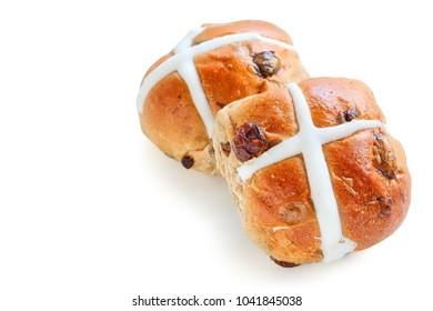 Freshly Baked Hot Cross Bun on White Background