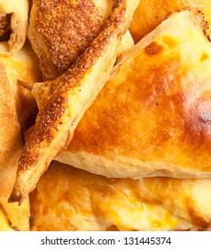 freshly baked italian cheese pies on the sacking