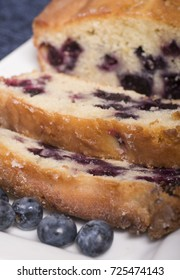 Freshly baked lemon blueberry bread sliced on a platter waiting to be served