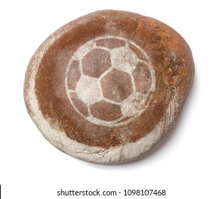 A freshly baked loaf of bread covered with rye flour in the shape of a soccer ball.(series)