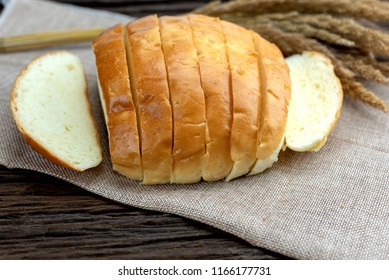 Freshly Baked Loaf of Yellow Potato Bread. Homemade potato bread on wooden table.