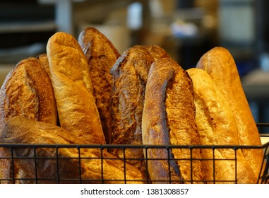 Freshly baked loaves of French bread in a basket