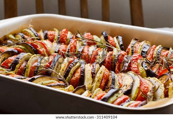 freshly baked mixture of satay and ratatouille in a cooking form