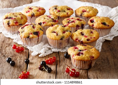 Freshly baked muffins with black and red currant berries close-up on the table. horizontal