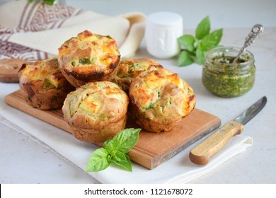 Freshly baked muffins with spinach, sweet potatoes and feta cheese on white background. Healthy food concept. Savory pastry.