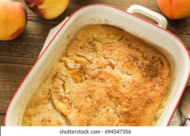 Freshly baked peach cobbler made with organic peaches.
