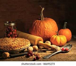 Freshly baked pie with pumpkin , nuts and cranberries on rustic table