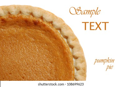 Freshly baked pumpkin pie on white background with copy space.
