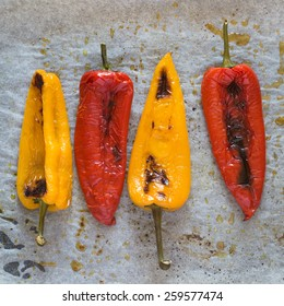 Freshly Baked Red and Yellow Peppers on Baking Paper