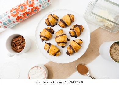 Freshly baked rugelach pastries with kitchen supplies