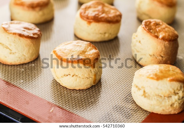 Freshly baked scones on silicon mat