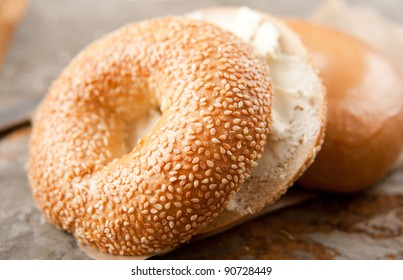 Freshly Baked Sesame Seed and Plain Bagels with Cream Cheese for Breakfast
