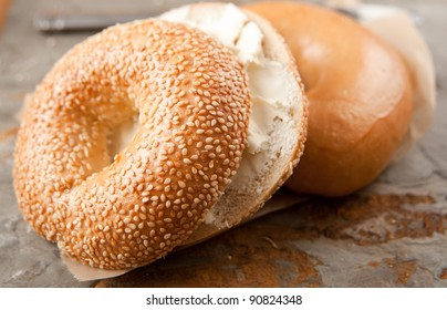 Freshly Baked Sesame Seed and Plain Bagels with Spread