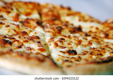 Freshly baked and sliced traditional Georgian Khachapuri on the plate, close up