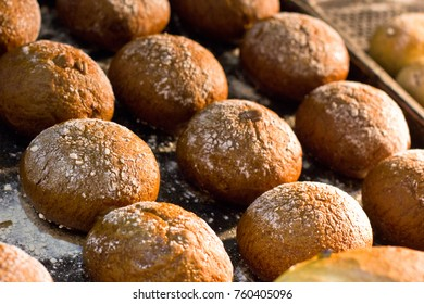 Freshly baked small hot rolls with the raisins.