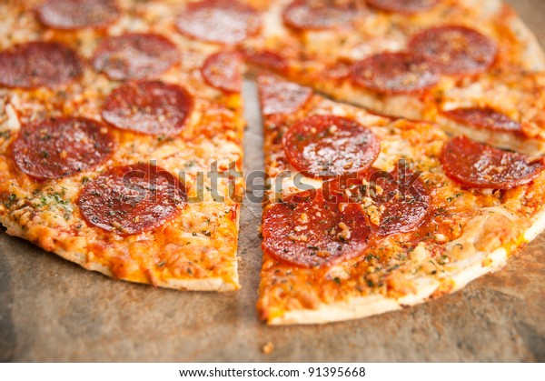 Freshly Baked Thin Crust Pepperoni and Cheese Pizza