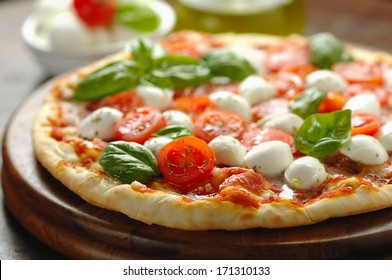 Freshly baked tomato and mozzarella pizza