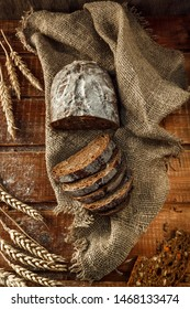 Freshly baked wheat bread, homemade cakes, still life with bread, crisp loaf of bread, still life on a rustic background, top view, rustic bread, roll, loaf.
