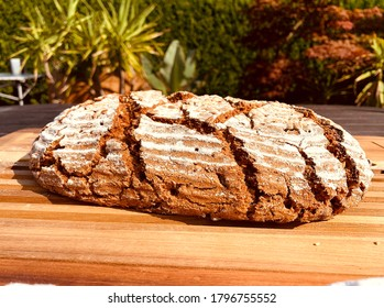 The freshly baked wholemeal bread doesn't just look delicious - Shutterstock ID 1796755552