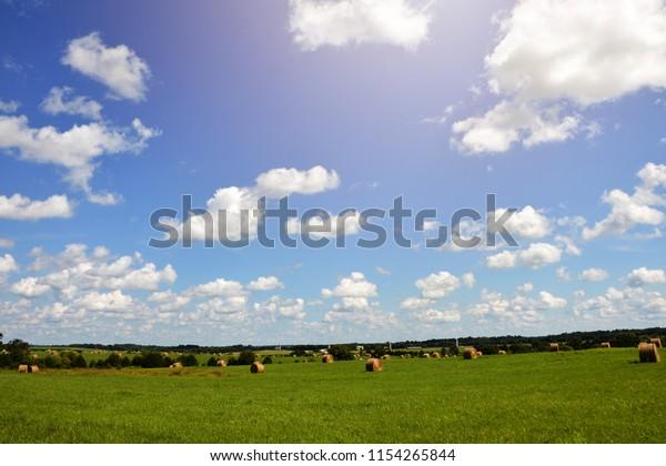 Freshly baled hay sits in fields in rural central Virginia.
