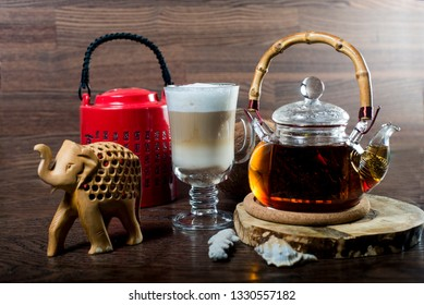 freshly brewed Chinese tea on the table surrounded by various accessories