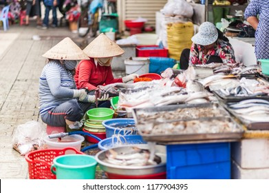 Freshly caught fish and other seafood for sale. Local delicacies displayed on a counter at a vintage Asian market of Ben Thanh. Ho Chi Minh City, Vietman.