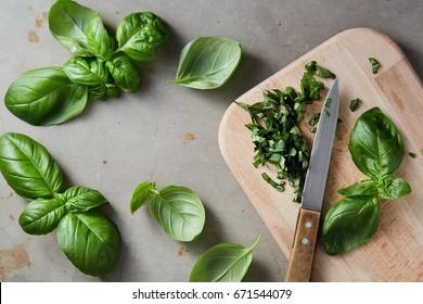 Freshly chopped basil leaves. Fresh basil on a wooden chopping board.