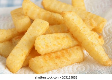 Freshly cooked crinkle cut chips or French fries