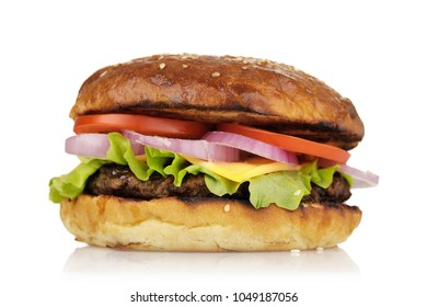 Freshly cooked hamburger with vegetables and cutlet. Home-made sandwich isolated on white background, closeup