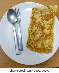 Freshly cooked omelette served in plate.Egg cooked to make omelette.Delicious omelette top shot.