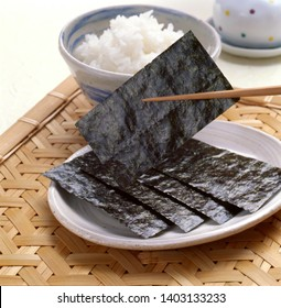 Freshly cooked rice and roasted Japanese seaweed, Japanese traditional breakfast.