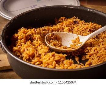 Freshly cooked rice with spices in a pot.