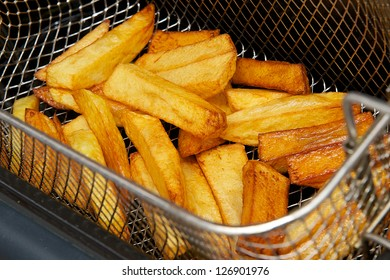 Freshly cooked steak cut chips fresh out of the hot oil from the fryer