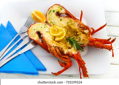 Freshly cooked tasty ocean crayfish served with herb butter and lemon
