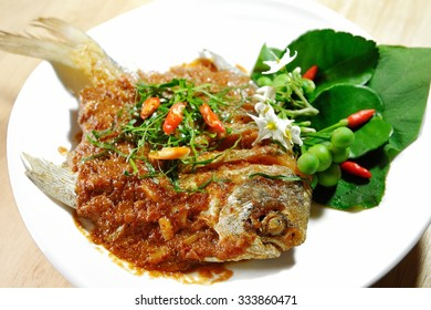 Freshly cooked Thai cuisine, Pompano fish with spicy curry hot and spicy taste for local food background