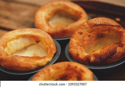 Freshly cooked Yorkshire Puddings for a Sunday roast dinner. British, English cuisine.