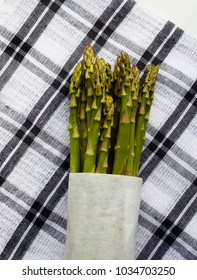 Freshly cut Asparagus from garden washed, wrapped the placed on kitchen cloth