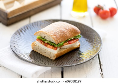 freshly cut bread sandwich ham cheese salad lunch ham cheese wooden rack plate