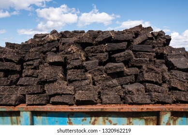 freshly cut fields of peat or turf from Scottish raised bog, peat removal, Durness, Scottish Highlands, Scotland, United Kingdom