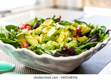 Freshly cut from organic products lettuce from green leaves of lettuce, tomatoes and avocado has all the active ingredients for weight loss, immunity, vitamins and amino acids, improves metabolism