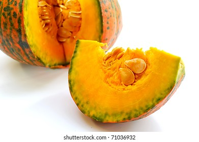 Freshly cut pumpkin on white background